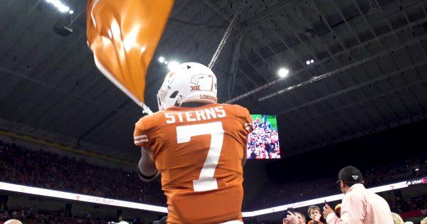 Image of Caden Sterns waving flag