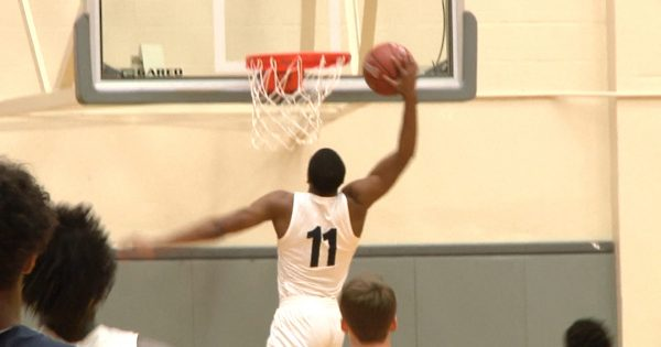 Image of a high school basketball player about to dunk